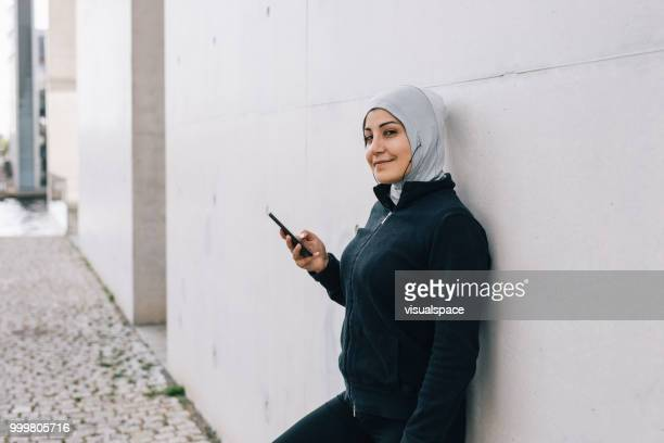 Portrait of muslim woman wearing sporting clothes.