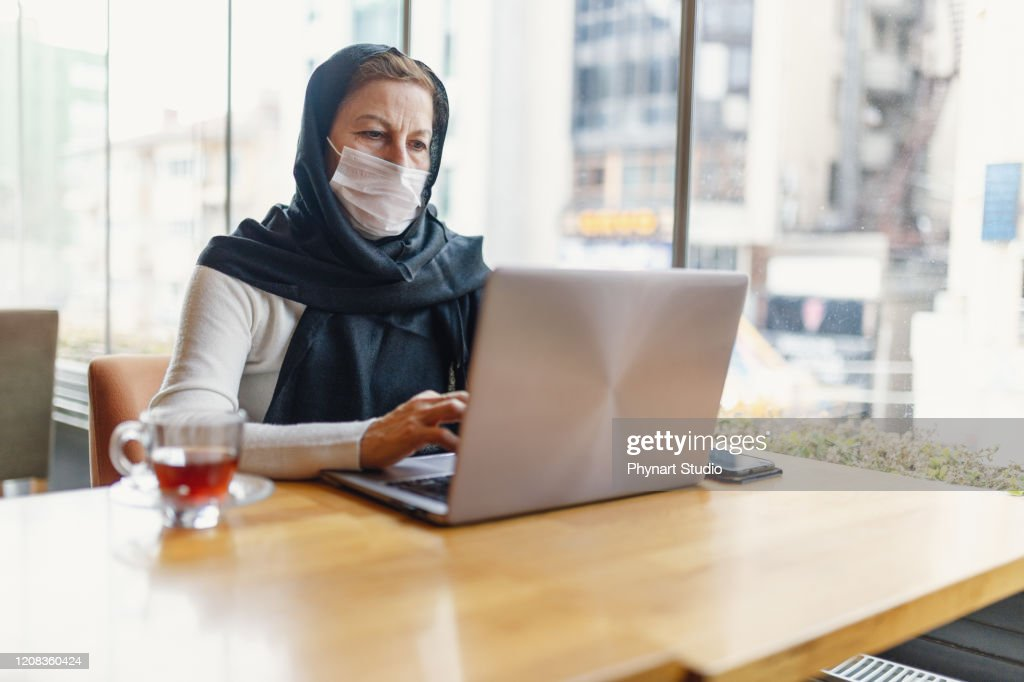 Portrait Of Muslim  Woman With Face Mask : Stock Photo