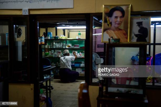 A portrait of Myanmar de facto leader Aung San Suu Kyi seen at right decorates the National League for Democracy HIV/AIDS Center in the outskirts of...