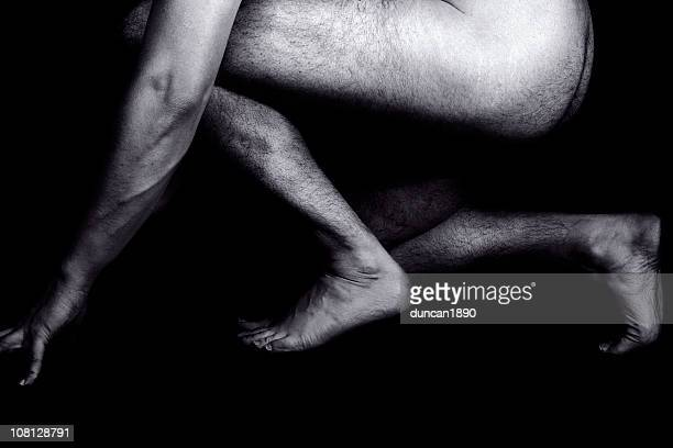 portrait of naked crouching male, black and white - naturist male stock pictures, royalty-free photos & images