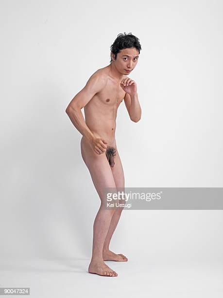 a portrait of naked man. - hombre desnudo fondo blanco fotografías e imágenes de stock