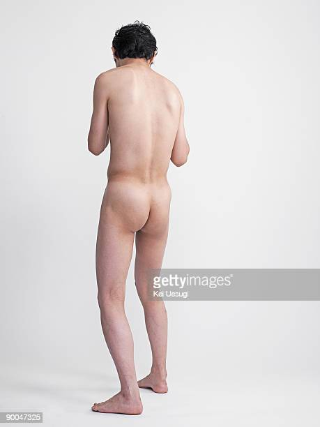 a portrait of naked man. - bare bottom stock pictures, royalty-free photos & images