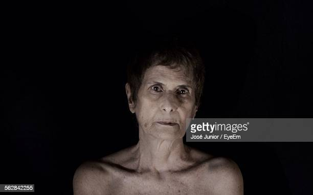 Portrait Of Naked Woman Against Black Background