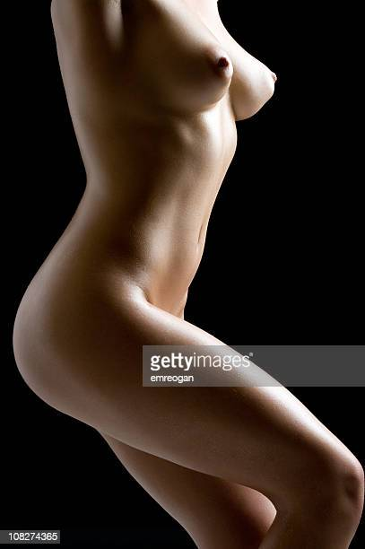 Portrait of Naked Woman's Body on Black Background