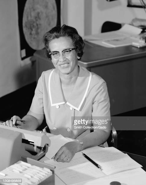 Portrait of NASA human computer and AfricanAmerican mathematical pioneer Katherine Johnson smiling at a desk with notes 1966 Image courtesy NASA