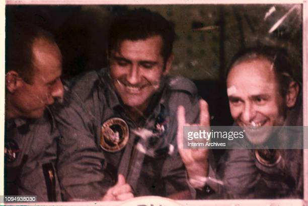 Portrait of NASA's Apollo 12 astronauts from left Alan Bean Richard Gordon and Charles 'Pete' Conrad Jr as they look out of the window of the Mobile...