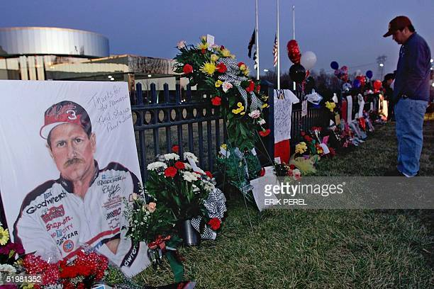A portrait of NASCAR driver Dale Earnhardt Sr adorns a memorial outside Earnhardt's corporate headquarters 19 February 2001 in Moorseville NC The...