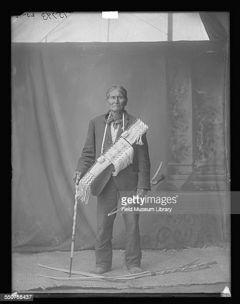 Portrait of Native American Apache Geronimo with bow arrow and cane at the Louisiana Purchase Exposition St Louis Missouri June 6 1904