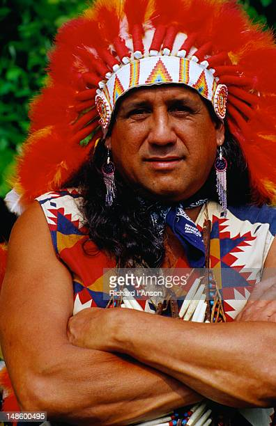 portrait of native american indian wearing traditional headdress. - cherokee culture stock pictures, royalty-free photos & images