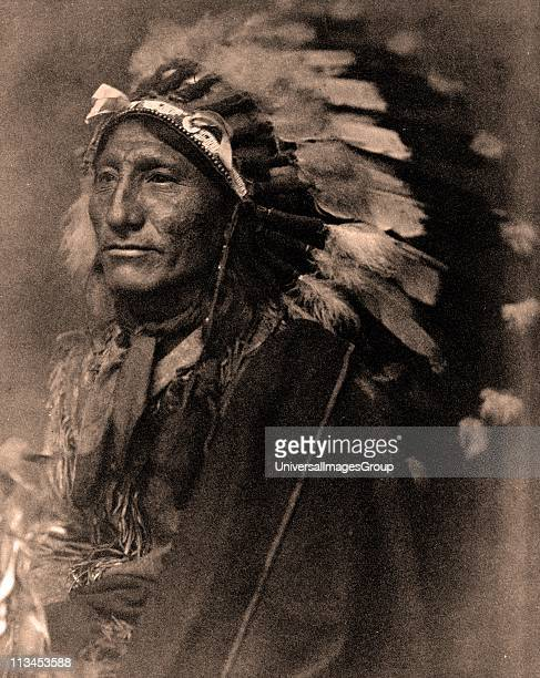 Portrait of Native American man in robe and feather headdress1902 Photograph by Gertrude Kasebier