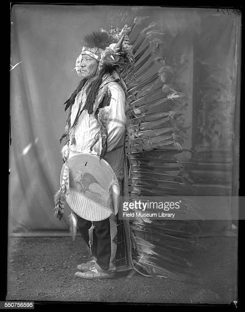 Portrait of Native American Oglala Sioux Chief Painted or Spotted Horse wearing a badge that reads 'Cummings Indian Congress Police' at the Louisiana...