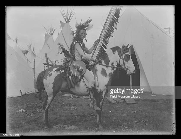 Portrait of Native American Oglala Sioux Comes Out Holy on a horse outside and in full costume at the Louisiana Purchase Exposition St Louis Missouri...