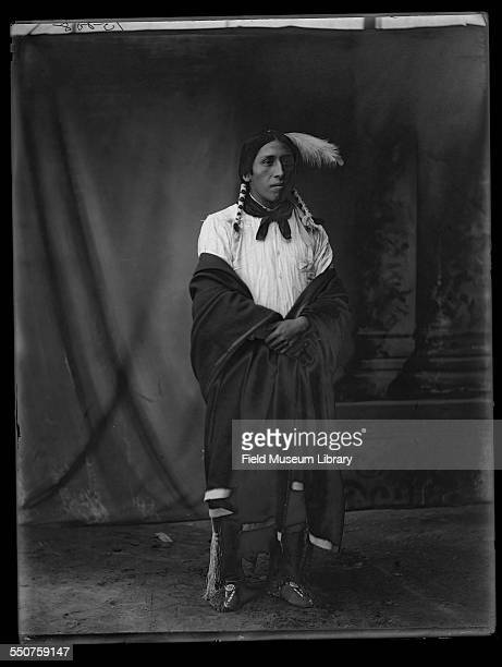 Portrait of Native American Wichita man Burgess Wheeler or Burgess Hunt aged 22 and dressed in native clothing at the Louisiana Purchase Exposition...