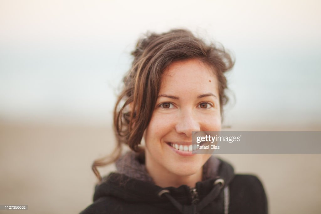 Portrait of natural young happy woman : Stock Photo