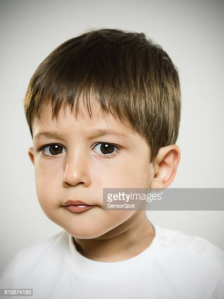 portrait of naughty kid looking at camera. - black hair stock pictures, royalty-free photos & images