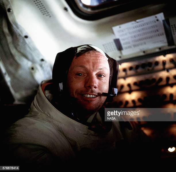 A portrait of Neil Armstrong aboard the Lunar Module Eagle on the lunar surface just after the first moon walk