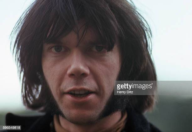 A portrait of Neil Young an original member of folkrock band Buffalo Springfield stands along San Francisco Bay shores at the time of the release of...