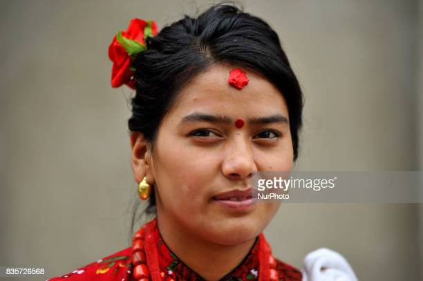 A Portrait of Nepalese girl in a traditional attire awaits to welcome cyclist after participating 20Km Ride to Khokana Cycling for the Cause...
