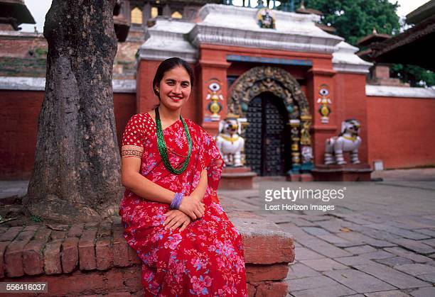 portrait of nepalese woman sitting outside temple, kathmandu, nepal - kathmandu stock pictures, royalty-free photos & images