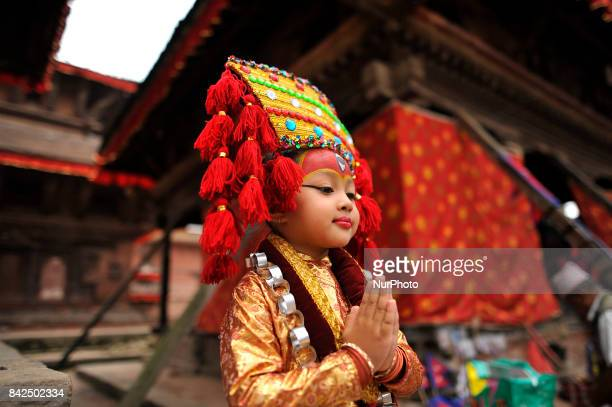 A Portrait of Nepalese young girl impersonate as a Kumari or living Goddess participate during celebration of Kumari puja at Basantapur Durbar Square...