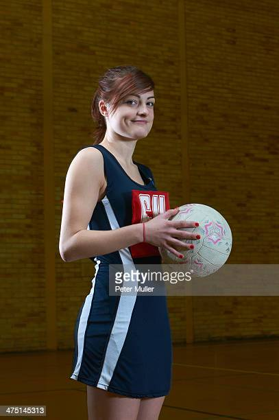 Portrait of netball player holding ball