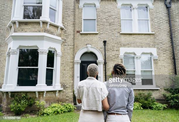 portrait of new homeowners admiring their investment - building exterior stock pictures, royalty-free photos & images