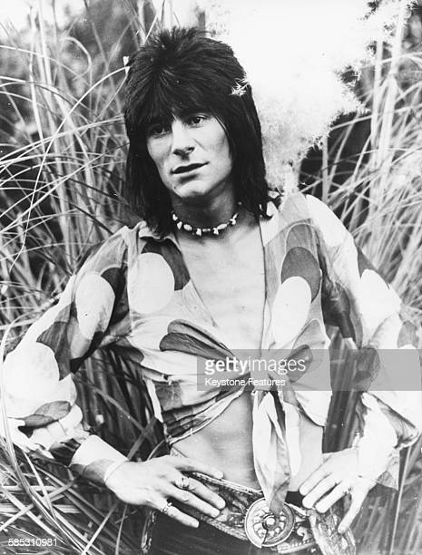 Portrait of new 'The Rolling Stones' guitarist Ronnie Wood wearing a shirt tied at the chest April 16th 1975
