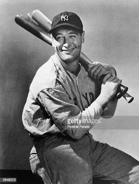 Portrait of New York Yankees first baseman, Lou Gehrig , seated with three baseball bats over his shoulder, circa 1930s.