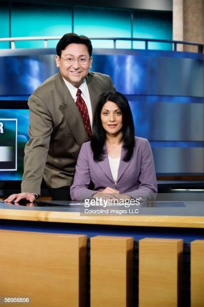 Portrait of news team in newsroom