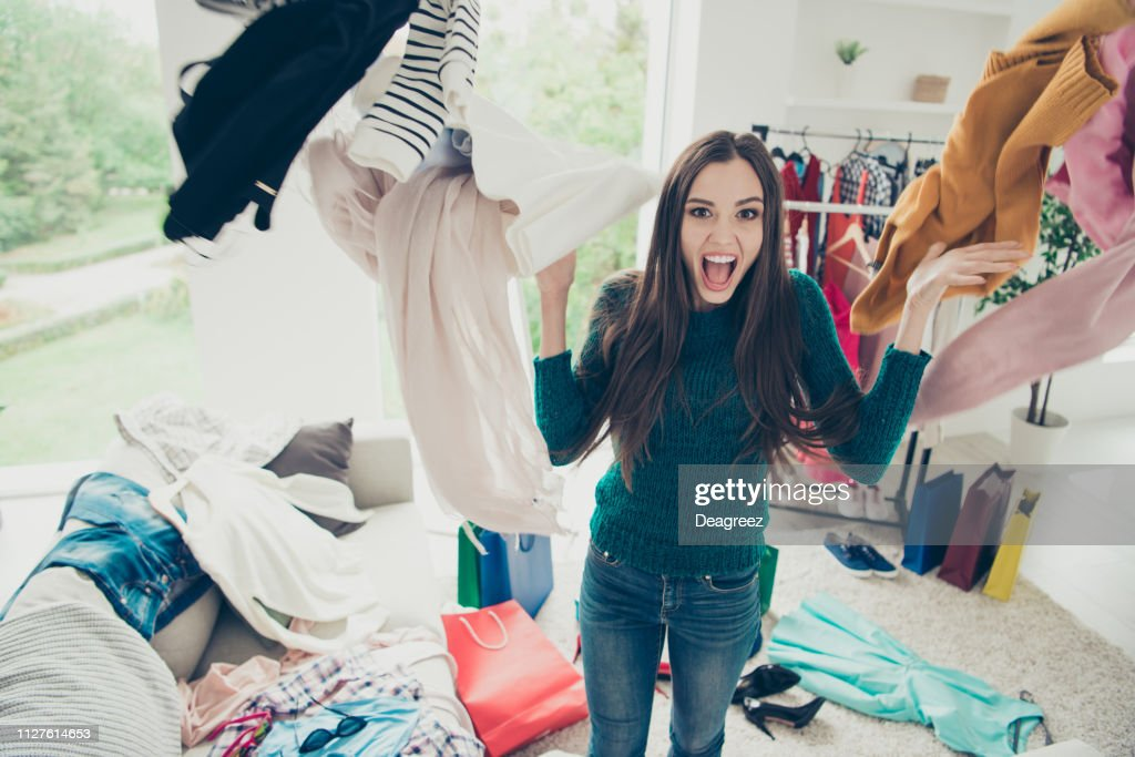 Portrait of nice cute attractive charming pretty cheerful cheery positive girl student throwing many different new things day dream daydream in light white interior room : Stock Photo