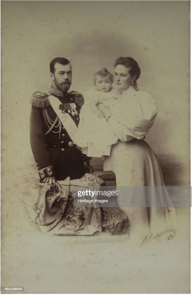 Portrait of Nicholas II of Russia with Alexandra Fyodorovna and Daughter Olga. Artist: Levitsky, Sergei Lvovich (1819-1898) : News Photo