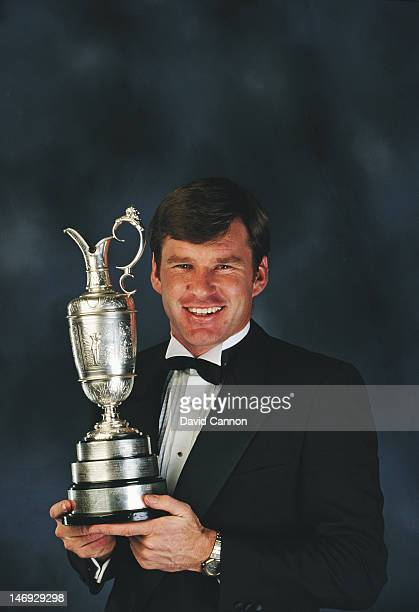 A portrait of Nick Faldo holding the Claret trophy for becoming British Open Champion in 1990 on 1st December 1990 in London England