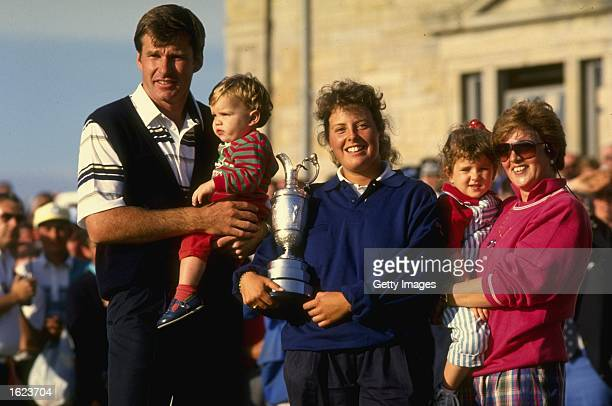Portrait of Nick Faldo of Great Britian with his two children his caddie Fanny Sunesson holding the Claret Jug and his wife Gill during the British...