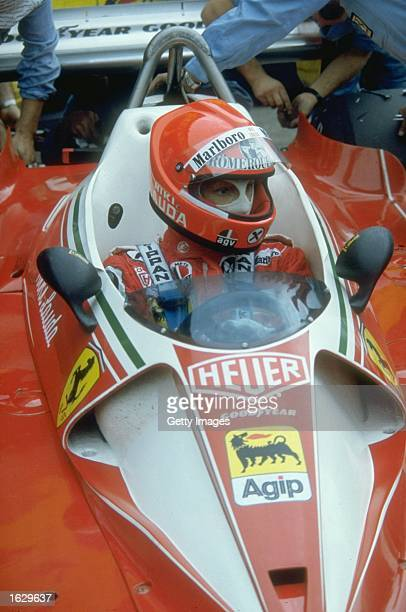 Portrait of Niki Lauda of Austria in his Scuderia Ferrari before the German Grand Prix at the Nurburgring circuit in Nuremberg Germany Lauda had an...