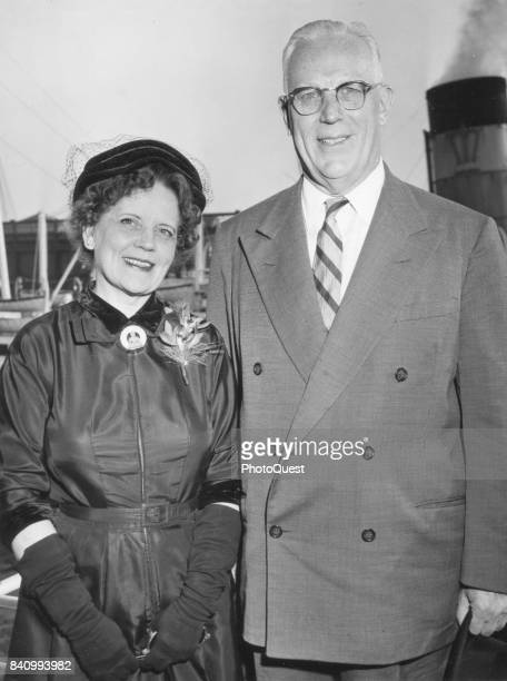 Portrait of Nina Warren and her husband Chief Justice of the United States Supreme Court Earl Warren as they pose on board the SS America New York...