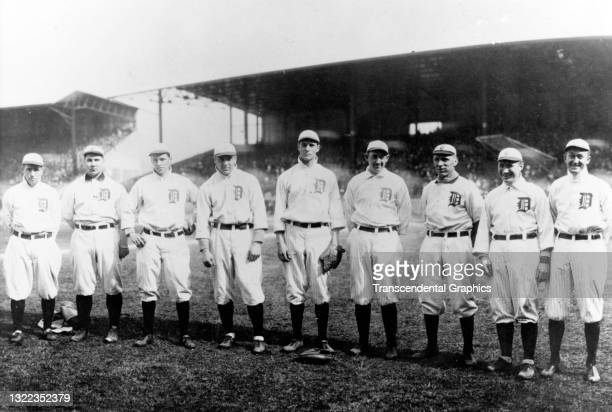 Portrait of nine members of the Detroit Tigers baseball team as they pose on the field at Bennett Park, Detroit, Michigan, 1910. Among those pictured...