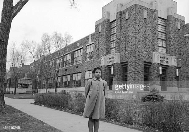 Portrait of nineyearold AfricanAmerican student Linda Brown as she poses outside Sumner Elementary School Topkea Kansas 1953 When her enrollment in...