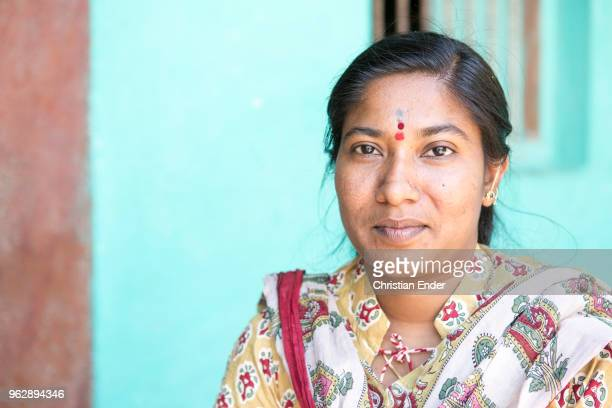 A portrait of Nirmala Naikar She is a social worker and working for the development aid program 'Jana Jagaran developing program' She is sitting in...