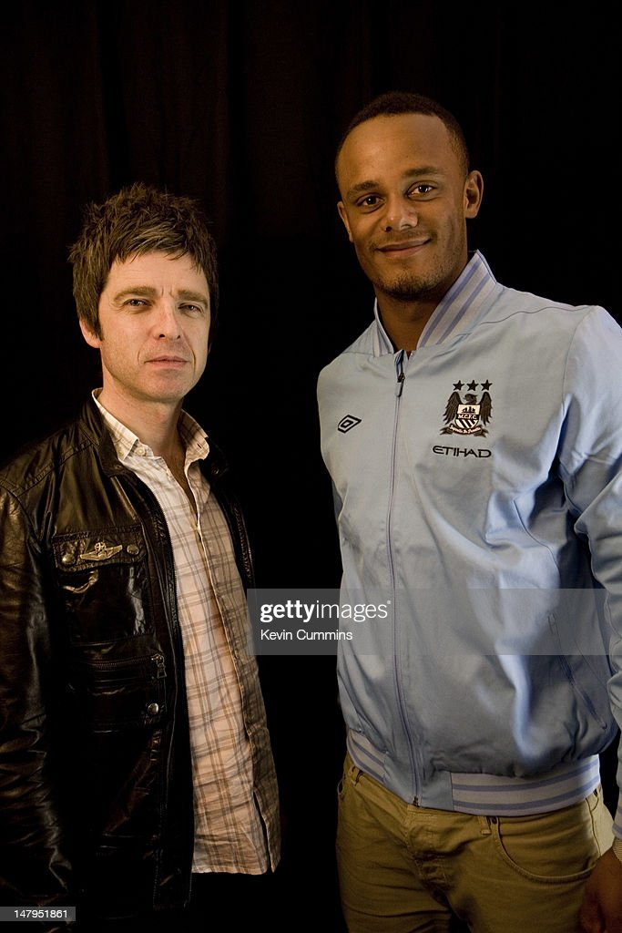 A portrait of Noel Gallagher with Belgian footballer and Manchester City captain Vincent Kompany backstage at the Rock Werchter Festival, Belgium, 1st July 2012.