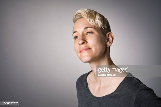 portrait of non-binary person - gender fluid stock pictures, royalty-free photos & images