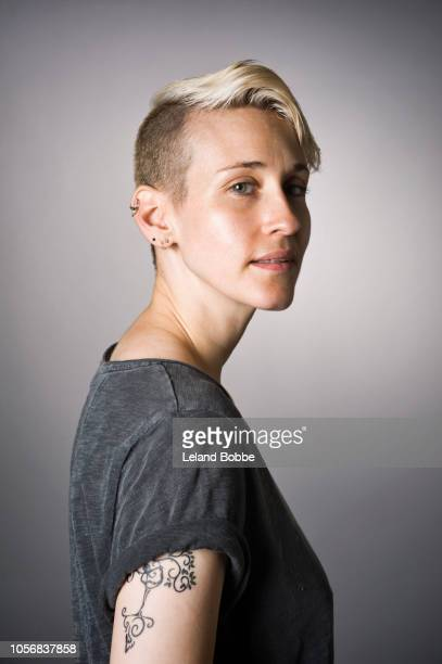 portrait of non-binary person - androgynous stock photos and pictures