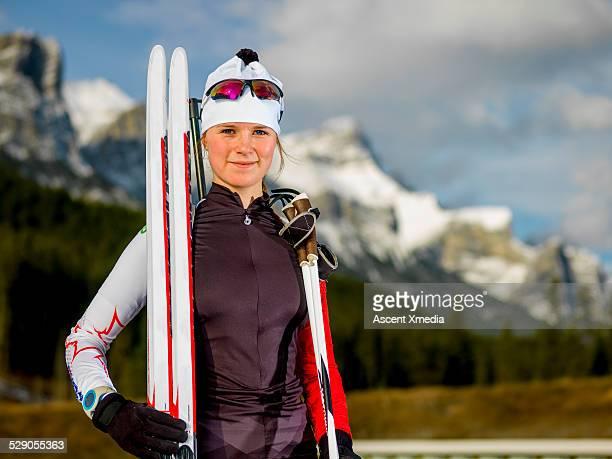 Portrait of nordic ski racer/biathlete,mtns behind