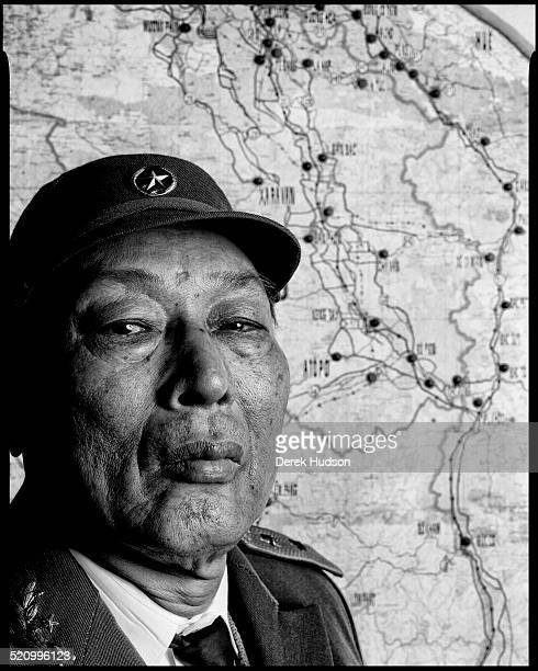 Portrait of North Vietnamese miltitary commander and politician LieutenantGeneral Dong Si Nyguen as he poses in front of a map Hanoi Vietnam 1995 The...