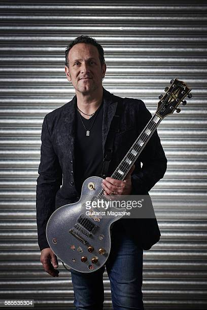 Portrait of Northern Irish musician Vivian Campbell, guitarist with hard rock group Def Leppard, photographed backstage before a live performance at...