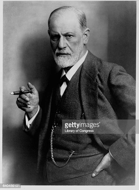 A portrait of noted psychoanalyst Sigmund Freud with a cigar
