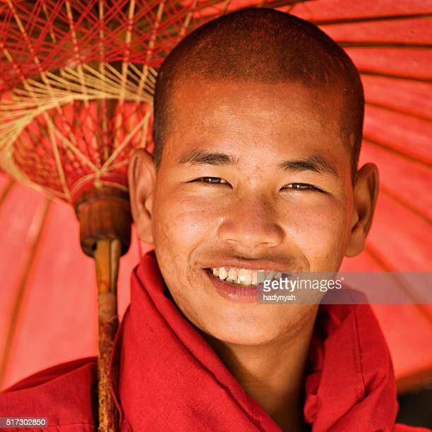Portrait of Novice Buddhist monk with umbrella