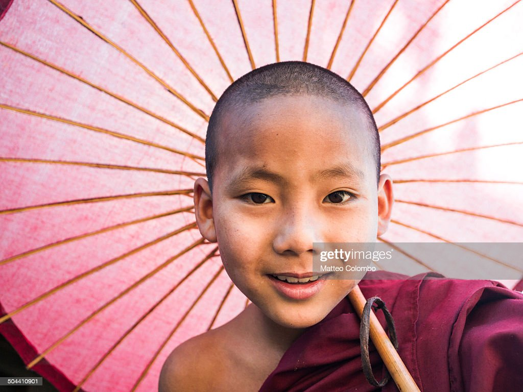 Myanmar, Mandalay division, Bagan. Portrait of young novice buddhist monk smiling.