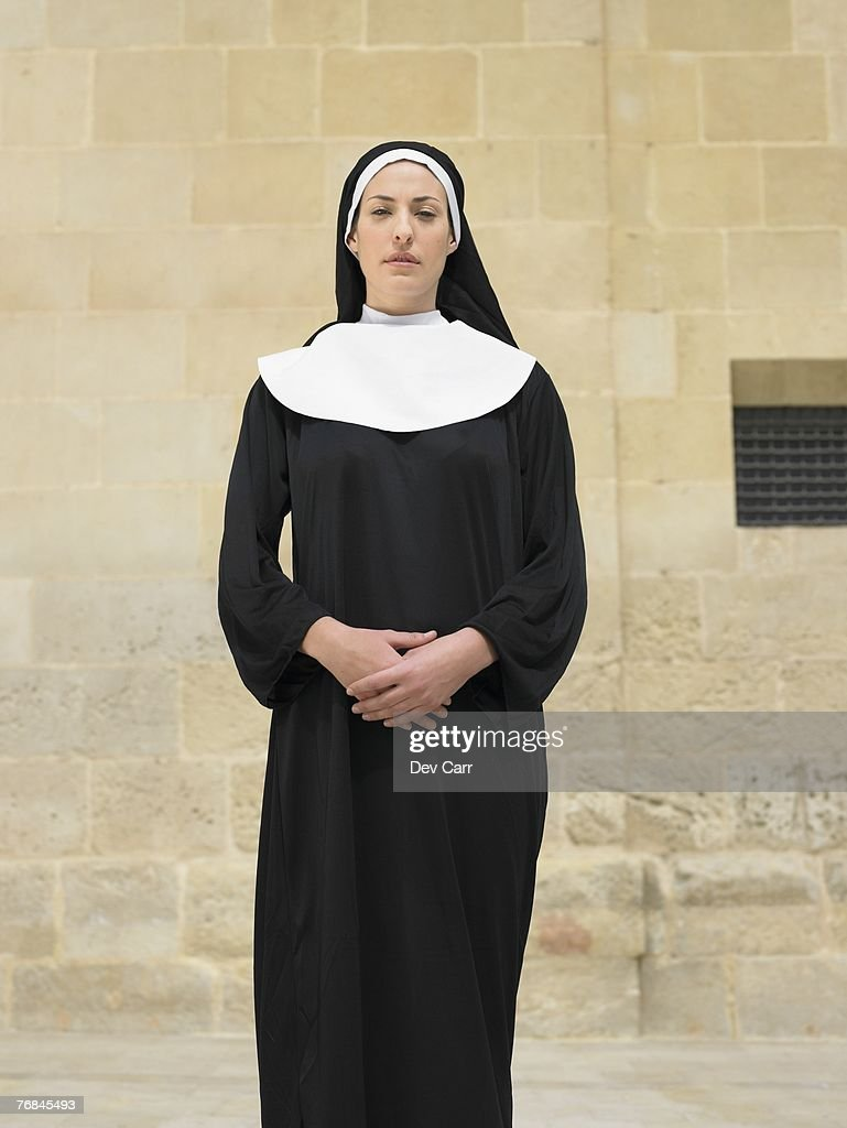 Portrait of nun clasping hands looking into camera, Alicante, Spain, : Stock Photo