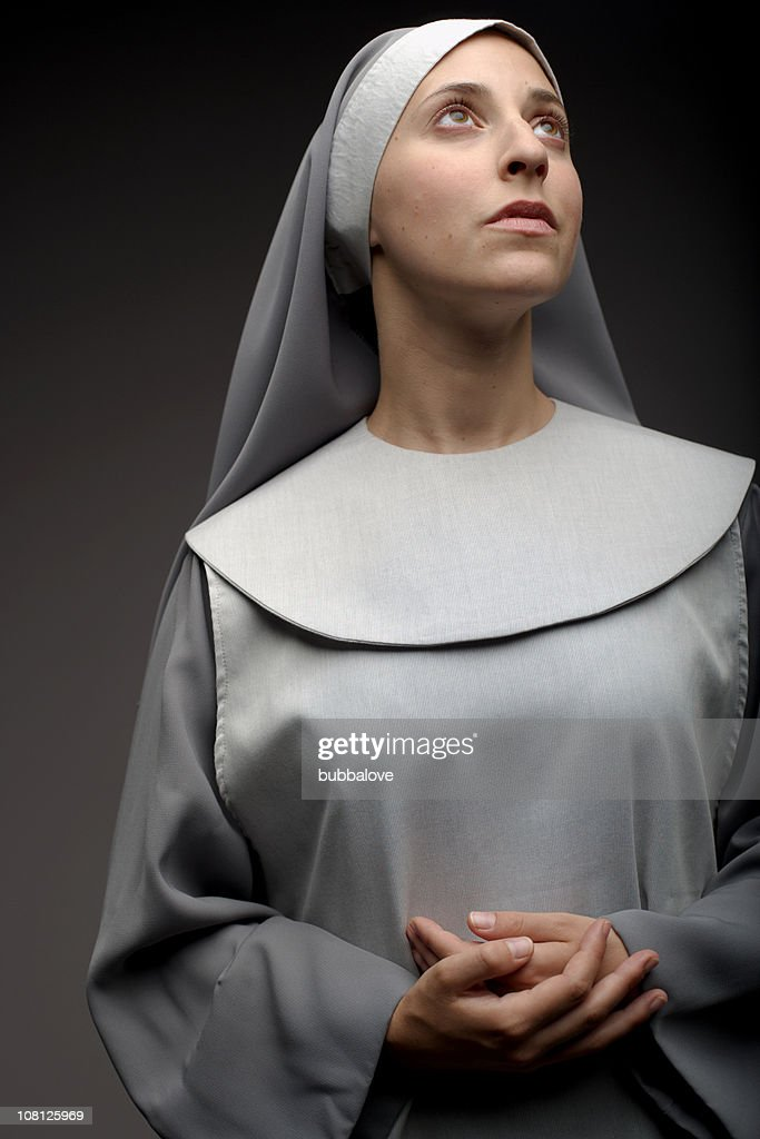 Portrait of Nun With Folded Hands and Looking Away : Stock Photo