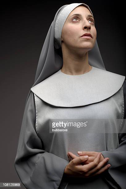 Portrait of Nun With Folded Hands and Looking Away